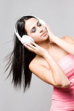 Gorgeous brunette music lover. Royalty Free Stock Photo