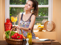 Gorgeous brunette preparing healthy meal. Stock Photos