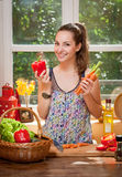 Gorgeous brunette preparing healthy meal. Stock Image