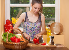 Gorgeous brunette preparing healthy meal. Royalty Free Stock Image