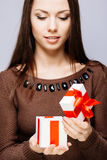 Gorgeous brunette with present Stock Image