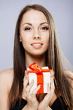 Gorgeous brunette with present Royalty Free Stock Photos