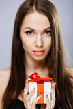 Gorgeous brunette with present Royalty Free Stock Photography
