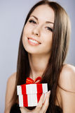 Gorgeous brunette with present Stock Photography