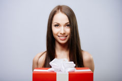 Gorgeous brunette with present Stock Images