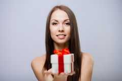 Gorgeous brunette with present Royalty Free Stock Images