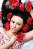 Gorgeous brunette with red aster Stock Images