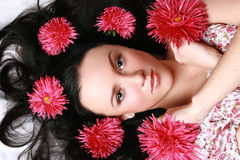 Gorgeous brunette with red asters Royalty Free Stock Photos