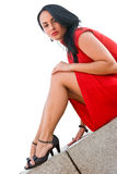 Gorgeous brunette in red dress Royalty Free Stock Image