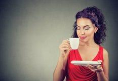Elegant woman enjoying coffee smell Royalty Free Stock Photos
