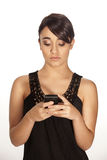 Gorgeous brunette sending a text Royalty Free Stock Image
