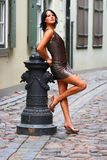Gorgeous brunette in sexual pose in Old Riga Stock Image