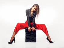 Gorgeous brunette sit on pouf Stock Photography