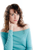 Gorgeous brunette in a turquoise dress posing in a studio Royalty Free Stock Photos