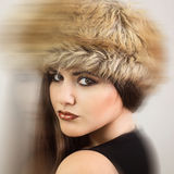 Gorgeous brunette wearing brown fur hat Stock Photo