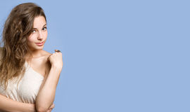 Gorgeous brunette woman on a blue banner. Stock Photography