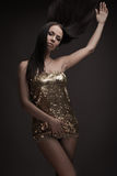 Gorgeous brunette woman dancing Royalty Free Stock Image