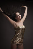 Gorgeous brunette woman dancing Stock Image