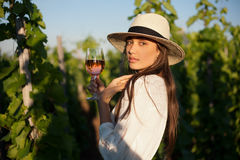 Gorgeous brunette woman having wine fun. Stock Image