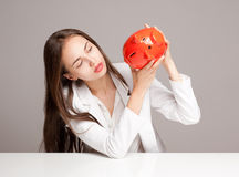Gorgeous brunette woman holding piggy bank. Stock Photos
