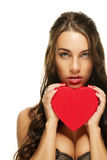 Gorgeous brunette woman holding red heart Royalty Free Stock Images