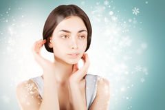 Gorgeous brunette woman over christmas background Royalty Free Stock Photography