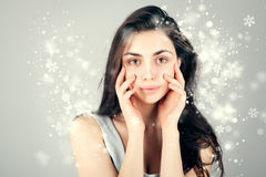 Gorgeous brunette woman over christmas background Royalty Free Stock Photos