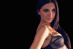 Gorgeous brunette woman wearing dark lingerie posing Royalty Free Stock Images