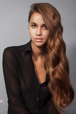 Gorgeous brunette young woman with long glamorous hair Stock Photography