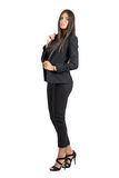 Gorgeous business beauty in black jacket and pants posing at camera. Stock Photo