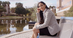 Gorgeous business woman sitting on bench Stock Photography