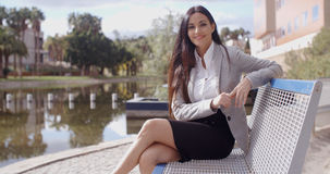 Gorgeous business woman sitting on bench Royalty Free Stock Images