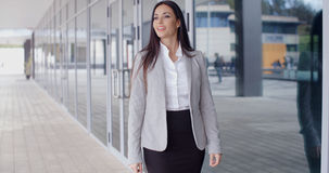 Gorgeous business woman walking Royalty Free Stock Image