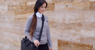 Gorgeous business woman walking past wall Stock Image