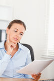 Gorgeous businesswoman concentrating on a paper Stock Photo