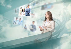 Gorgeous businesswoman using digital interface Stock Photo