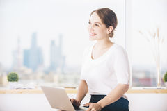 Gorgeous businesswoman using laptop Royalty Free Stock Images