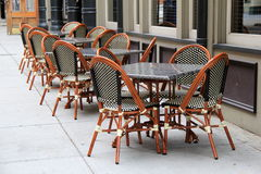 Gorgeous cane chairs and tables outside restaurant Stock Photography