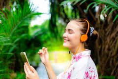 Gorgeous caucasian woman is listening nice music that can heal d stock photography
