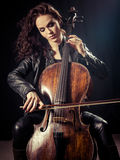 Gorgeous cellist. Photo of a beautiful female musician playing a cello Royalty Free Stock Image