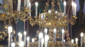 Gorgeous chandelier in the church.  stock footage