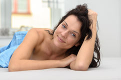 Gorgeous charismatic woman relaxing in bed Royalty Free Stock Images