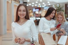Young women enjoying shopping together at the mall stock photo