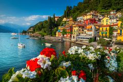 Gorgeous cityscape and harbor with boats, Varenna, lake Como, Italy. Wonderful summer holiday resort, colorful mediterranean buildings and luxury villas with royalty free stock photography