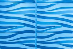 Gorgeous closeup detailed view of interior luxury decorative wall,smooth wavy blue background. Beautiful gorgeous closeup detailed view of interior luxury wall Stock Photos