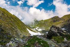 Gorgeous cloudscape over the Fagaras mountains. Beautiful summer landscape of Romania Royalty Free Stock Image