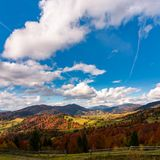 Gorgeous cloudscape over the mountains. Beautiful countryside landscape in autumn royalty free stock photo