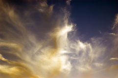 Gorgeous cloudy background. Beautiful clouds swirl around each other on the hot summer wind stock photography