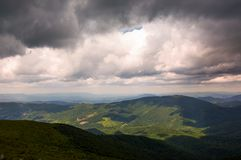 Gorgeous cloudy sky over the mountains. Beautiful landscape in summer time Royalty Free Stock Photography