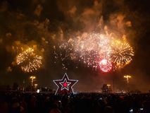 Gorgeous colorful fireworks on Victory Day. Crowd of people watching fireworks. Moscow, stock images